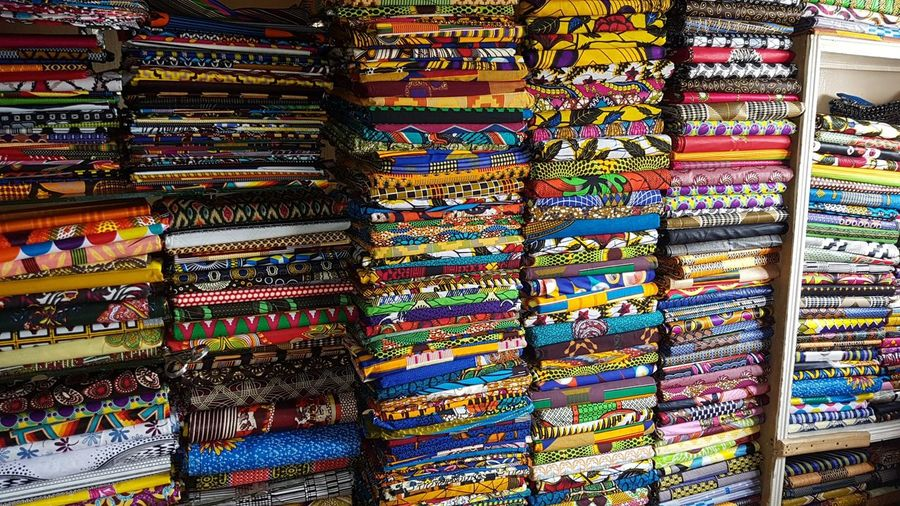 Fabrics, lots of them... Senegal Senegal Africa Fabric Multi Colored Backgrounds For Sale Pattern Textile Abundance Stack Choice