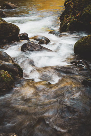 Stream flowing through rocks in sea