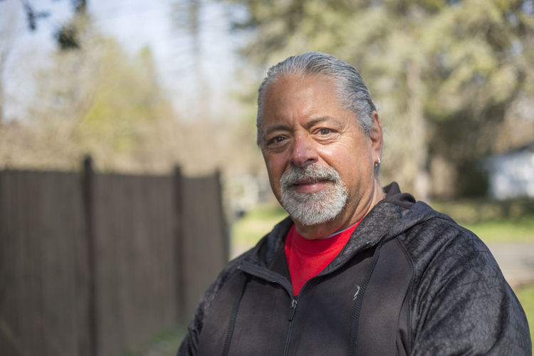 A horizontal image of good looking older man with salt and pepper hair, outdoors on a nice day. Adult Adults Only Beard Day Focus On Foreground Gray Hair Headshot Leisure Activity Lifestyles Looking At Camera Men Nature One Man Only One Person One Senior Man Only Only Men Outdoors People Portrait Real People Salt & Pepper Hair Senior Adult Senior Men Smiling Warm Clothing
