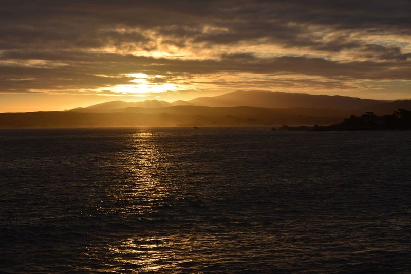 Sunrise at Pacific Grove Beauty In Nature Sea Water Sky Tranquil Scene Mountain Waterfront Dramatic Sky Seashore Sunrise morning Dramatic Outdoors