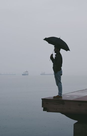 Best EyeEm Shot Decisions EyeEm Selects EyeEm Gallery Loneliness Lonely Melancholic Landscapes Foggy Full Length Horizon Over Water Nostalgic  One Person Outdoors Raining Day Sea Sky Thoughts Umbrella Water