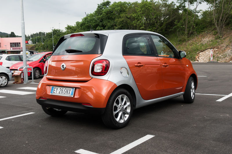 Kozina, Slovenia - May 24, 2017 : The Smart Forfour is a supermini car. The second generation Forfour, jointly developed with Renault. ForFour Mercedes-Benz Smart Car Editorial  Europe Illustrative Editorial Land Vehicle Minicar Mode Of Transport New Model Smart Forfour Orange Color Outdoors Renault Smart Car Superminicar Transportation