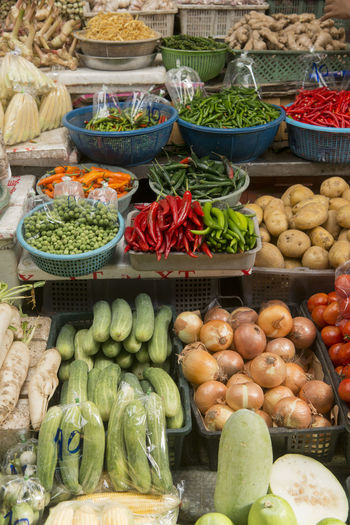 High angle view of various vegetables for sale arranged at market stall