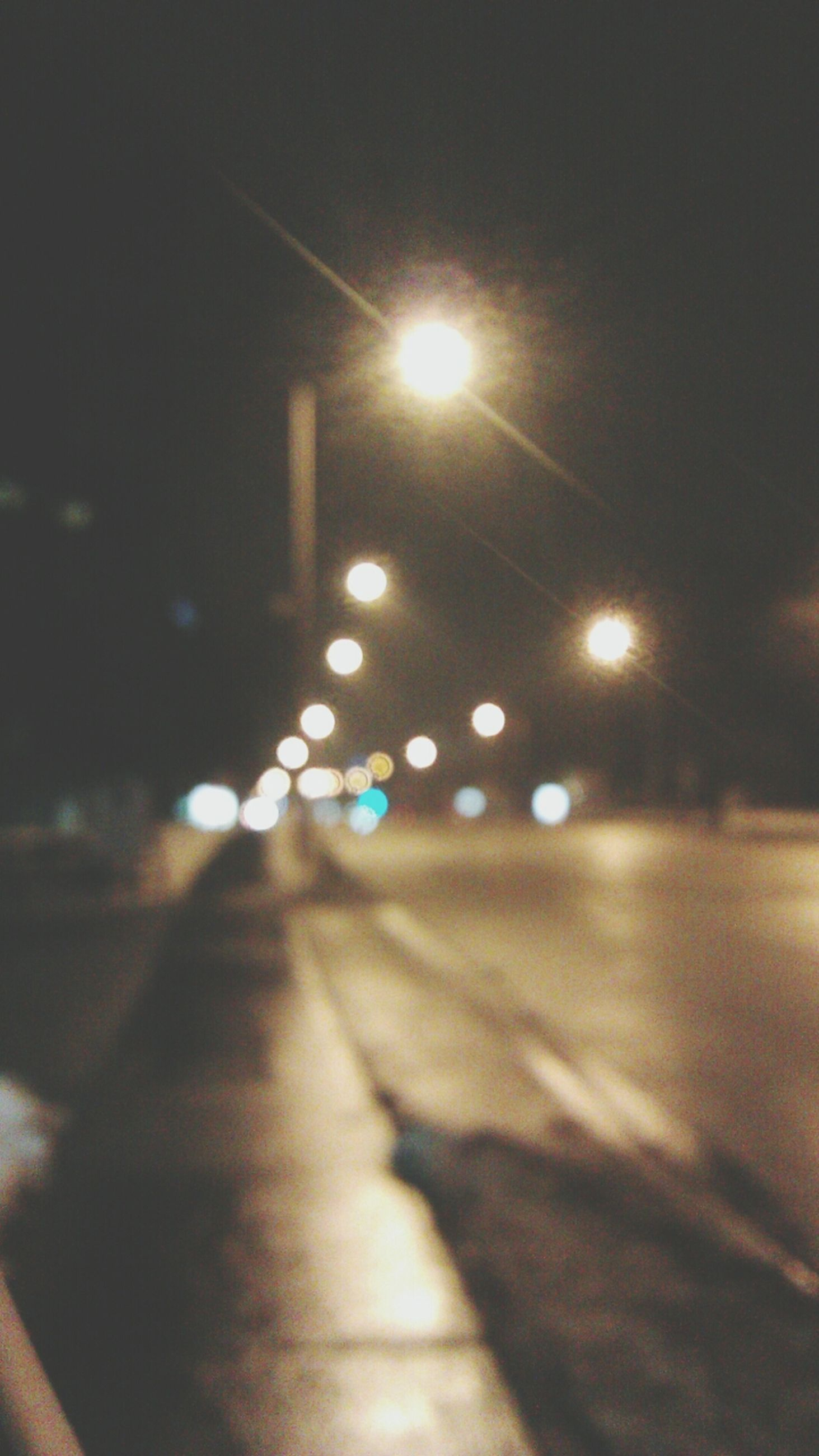 illuminated, night, transportation, street, lens flare, road, defocused, car, land vehicle, lighting equipment, focus on foreground, sunlight, no people, outdoors, light - natural phenomenon, mode of transport, shadow, street light, close-up, selective focus