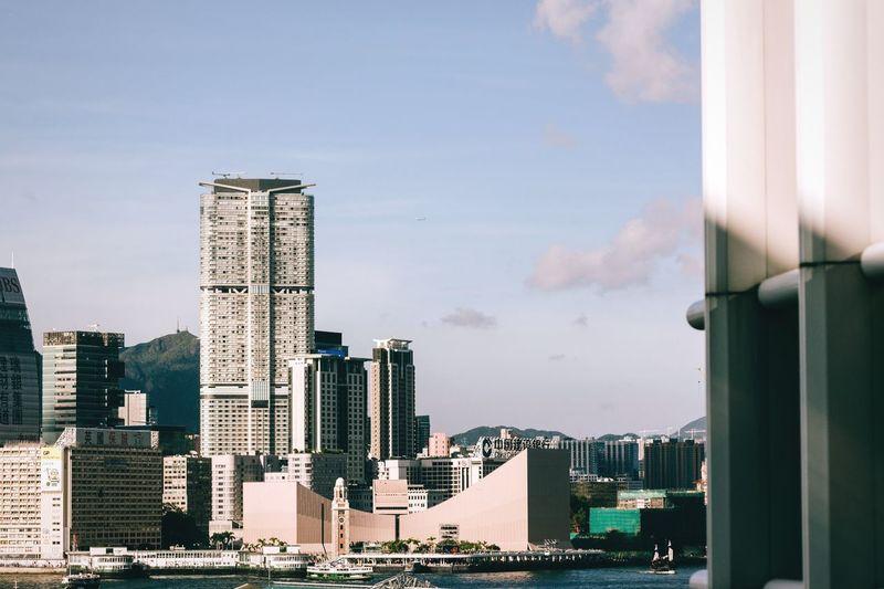Skyscrapers in city against sky