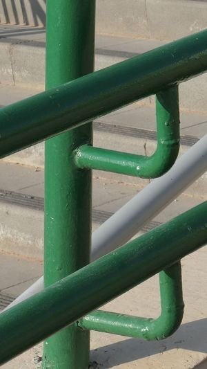 City Street Green Color No People Metal Day Pipe - Tube Outdoors Architecture Sunlight Railing Close-up