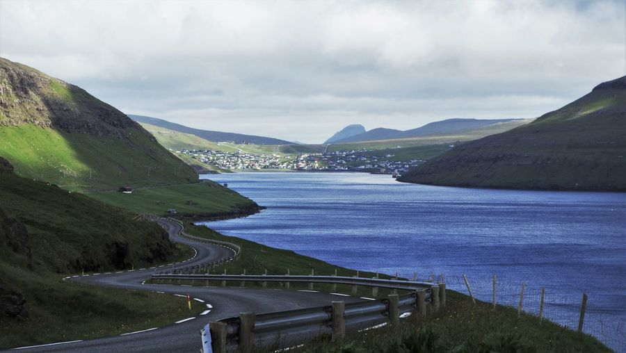 Sorvagur on the faroe islands seen from the curvy winding road north of the small town. Beauty In Nature Clouds Cloudy Cultures Curve Curve Curvy Curvy Road Day Faroe Islands Fjord Green Idyllic Landscape Landscapes Moor  Mountain Outdoors Road Road Marking Scenics Tranquility Travel Destinations Winding Road Winding Roads