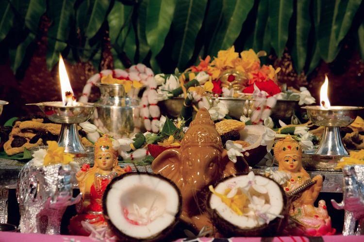 Ganesha festival hindu religious festival Ganesha God Godess Hindu Festival Pooja Rituals & Cultural Chaturthi India Culture Flower Flame Candle Burning Close-up Diya - Oil Lamp Oil Lamp Hinduism Traditional Festival Serving Size Prepared Food Bonfire Served Candlelight