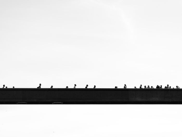 Group of people against the sky