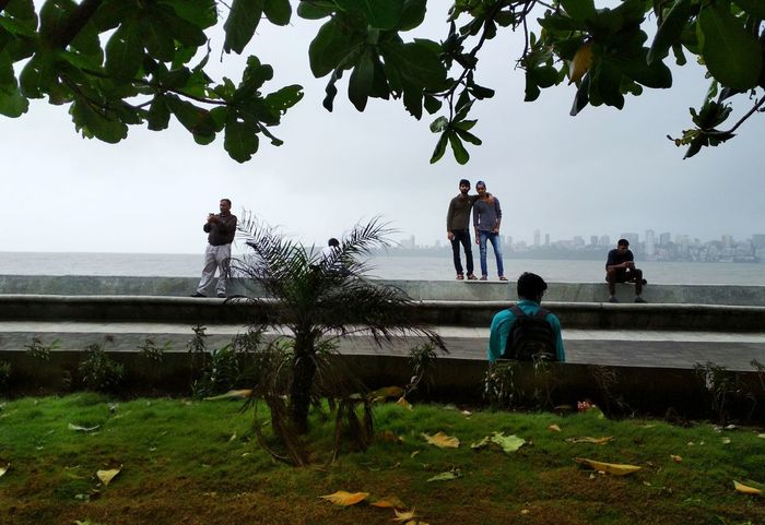 Tree Water People Outdoors Sea Adult Green Color Day Men Nature Large Group Of People Togetherness Adults Only Beach Sky Nautical Vessel Only Men Candid Candid Photography Young Adult Nature Built Structure Standing Tree Cloud