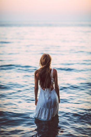 Sunset Sexygirl Back EyeEmNewHere Water Sea Real People Standing Leisure Activity Rear View Three Quarter Length One Person Women Waterfront Lifestyles Hairstyle Hair