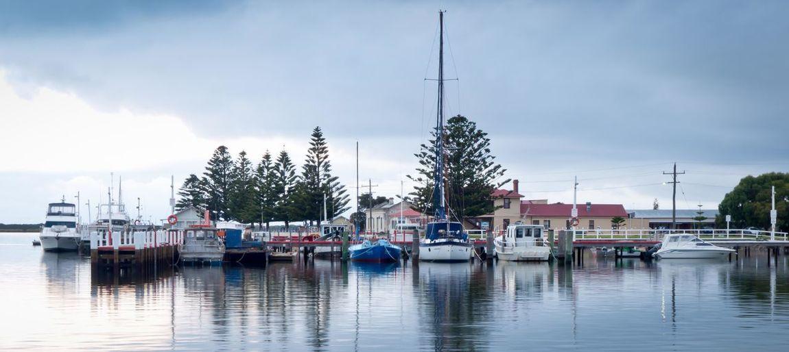 Boats moored in marina