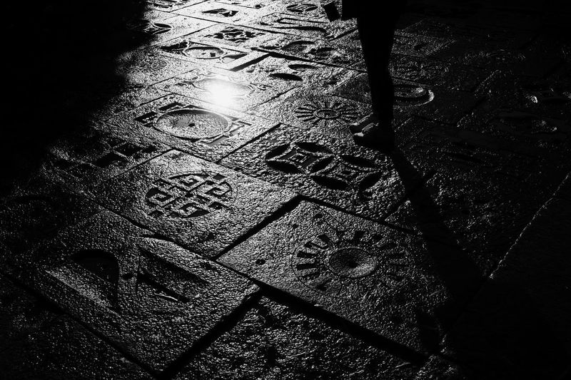 Low section of text on street at night