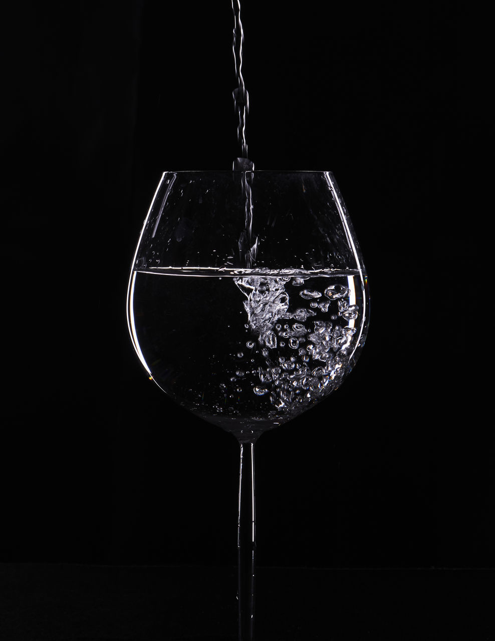 CLOSE-UP OF WINEGLASS IN GLASS