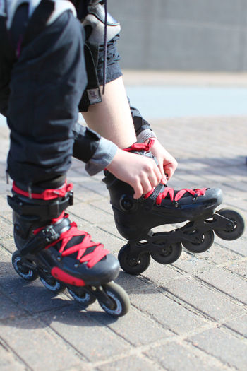 Low section of woman wearing roller skates