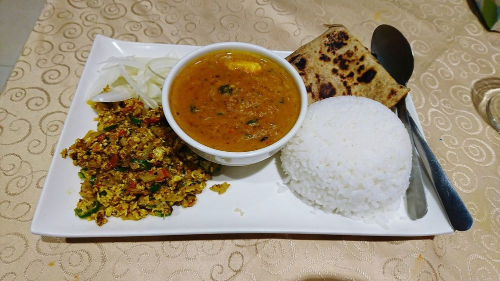 Indian food Chapati Rice Curry Egg Burji Burji Fried Egg Pickle Indian Food Food And Drink Food Ready-to-eat Plate No People Table Indoors  Freshness Healthy Eating Indulgence Serving Size Close-up