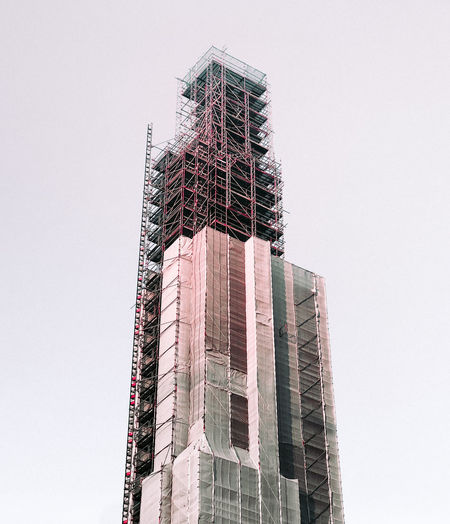 Low angle view of under construction building against clear sky