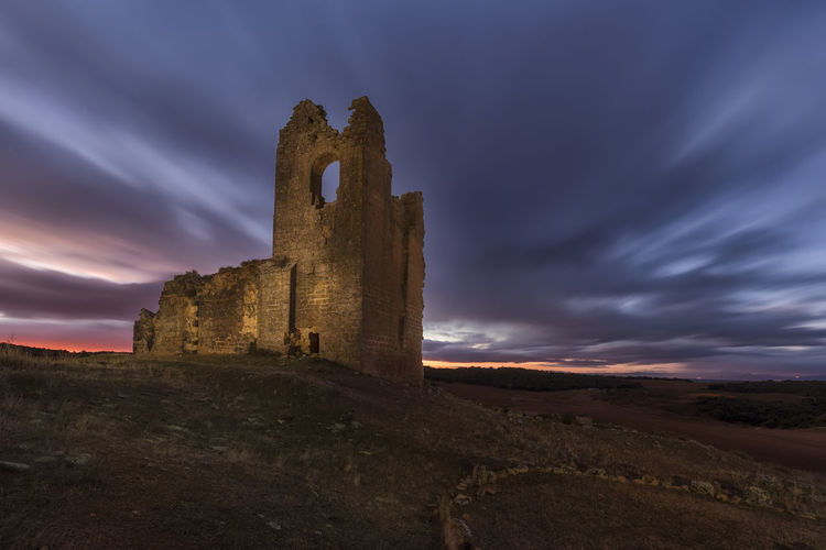 Old ruin building against sky during sunset