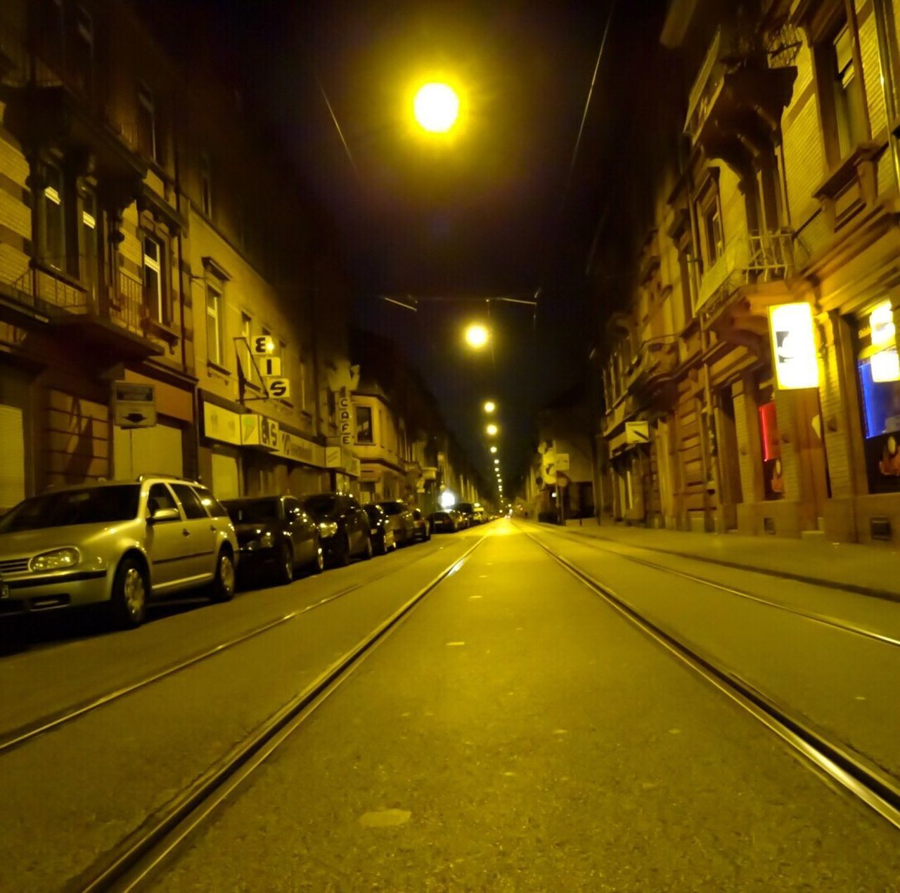 illuminated, night, architecture, building exterior, built structure, transportation, street, the way forward, city, no people, outdoors, sky