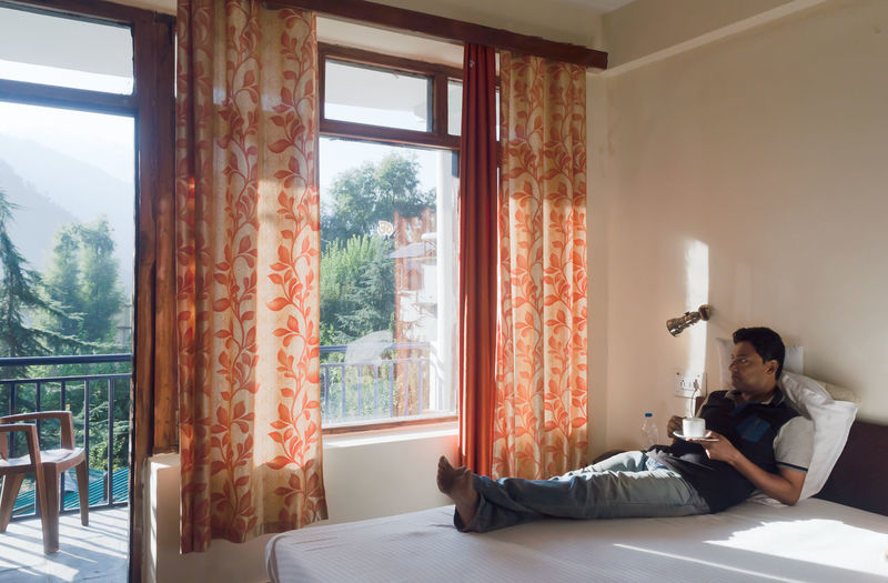 Man sitting by window at home