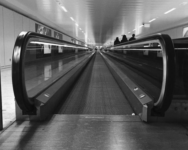 Illuminated Indoors  No People Moving Walkway  Architecture Day Traveling Home For The Holidays Movement Moving Escalator Escaping Travel Traveling Blackandwhite Monochrome Airport