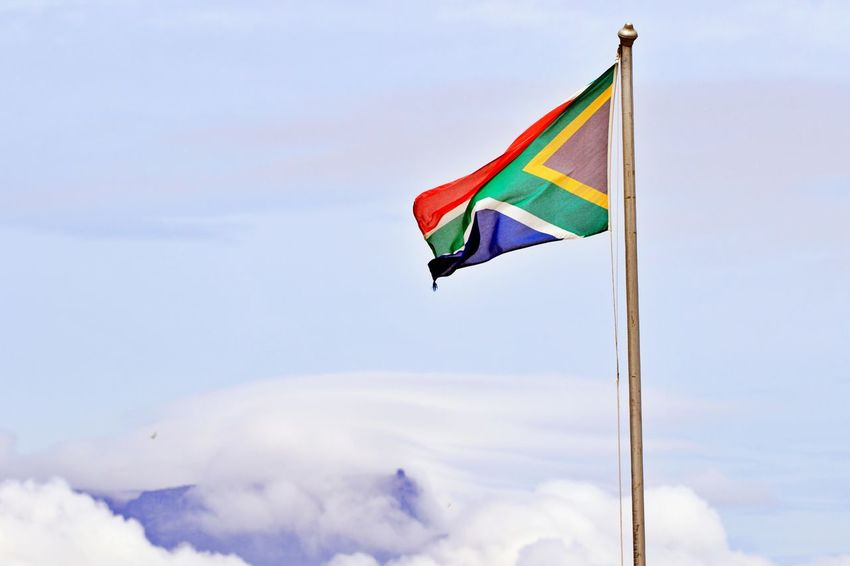Flag Sky Cloud - Sky Wind Waving Low Angle View Pole No People Outdoors Environment South African Flag Cloud Covered Mountains Table Mountain