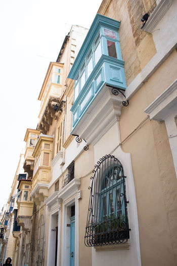 Architecture Built Structure Building Exterior Window Building Low Angle View Residential District No People Day Sky City Nature Outdoors Balcony Clear Sky House Entrance Lighting Equipment Door Town Valetta Valetta,Malta Houses And Windows Blue Window
