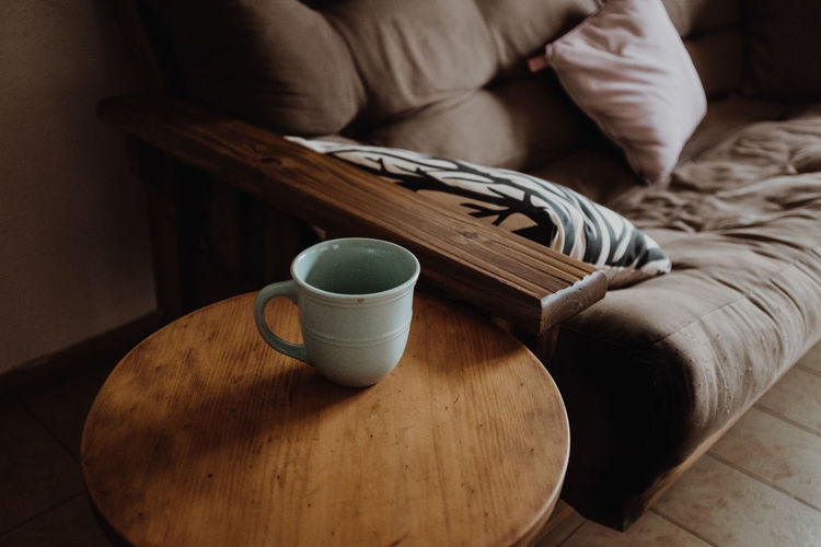 Wood - Material Indoors  Cup Table One Person Drink Food And Drink Mug High Angle View Refreshment Real People Furniture Coffee Cup Home Interior Midsection Tea Lifestyles Still Life Leisure Activity