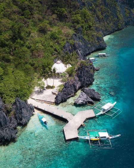 Can't stop staring at those blue waters and huge limestones of Matinloc Shrine, a spiritual oasis for locals and popular tourist attraction. Wish I could spend more time there diving off the boats 😌 High Angle View Water Beach Day Aerial View Outdoors Sea Nature No People Beauty In Nature