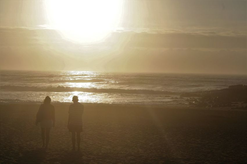 Beach Bonding Friendship KwaZulu-Natal Coast Nature Outdoors Real People Rear View Scenics Sea Silhouette Sunlight Sunset Togetherness Two People Vacations