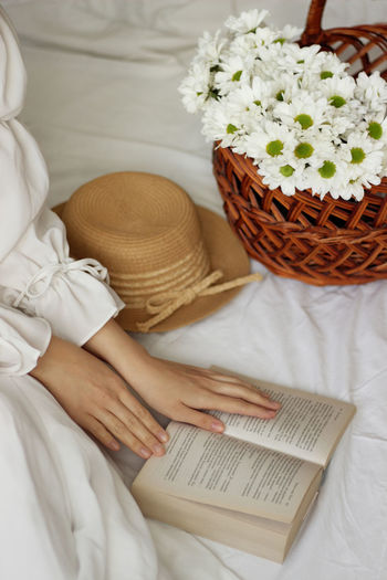 High angle view of woman reading book