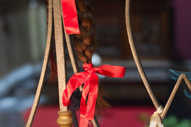 © www.rodiphotography.com No People Feelings Emotional Photography Emotions Daily Life Serenity Christianity Religion Religion And Beliefs Religion And Tradition Red Hair Hanging Christmas Present Ribbon - Sewing Item Christmas Tied Knot Tied Bow Bauble