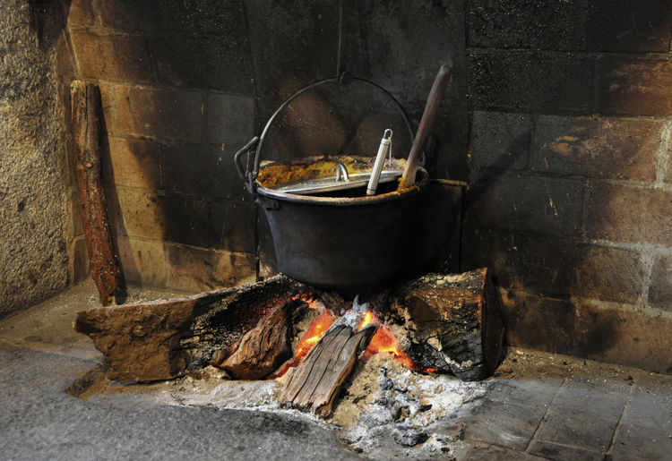 Cooking container on wood burning stove