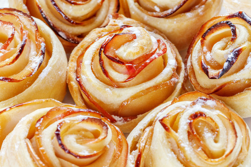 Appetizing ruddy buns-roses with apple slices. Background Ruddy Sugar Appetising Apple Slices Backgrounds Baked Baked Pastry Item Buns Close-up Dessert Food Food And Drink Freshness Handmade Indoors  No People Puff Pastry Ready-to-eat Rosettes Sweet Food Sweet Pie
