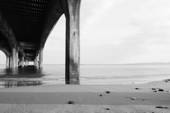 EyeEm Selects Water Sea Beach Land Sky Horizon Over Water Horizon Scenics - Nature Nature Architecture Built Structure Beauty In Nature Sand Tranquility Architectural Column Day Tranquil Scene Bridge No People Underneath