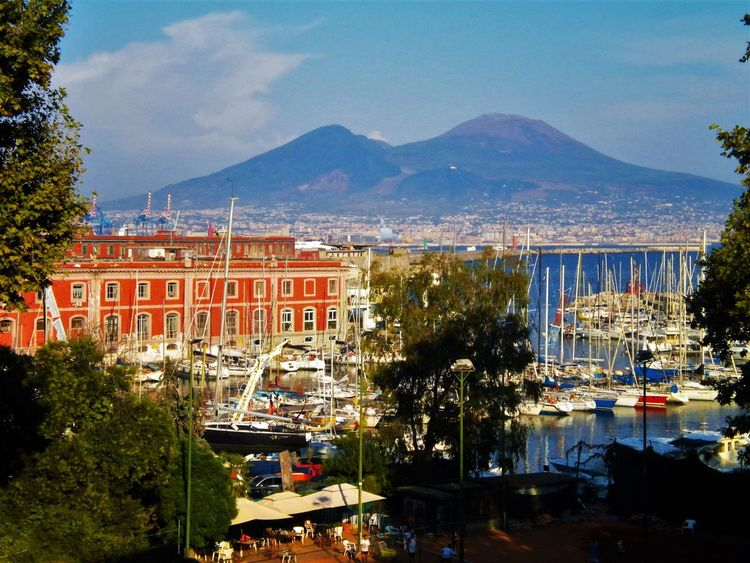 Harbor Vesuvio Architecture Beauty In Nature Boats Building Exterior Built Structure City Cityscape Day Mountain Mountain Range Nature No People Outdoors Sea Sky Tree Volcano Water Yacht in Napoli, Italy
