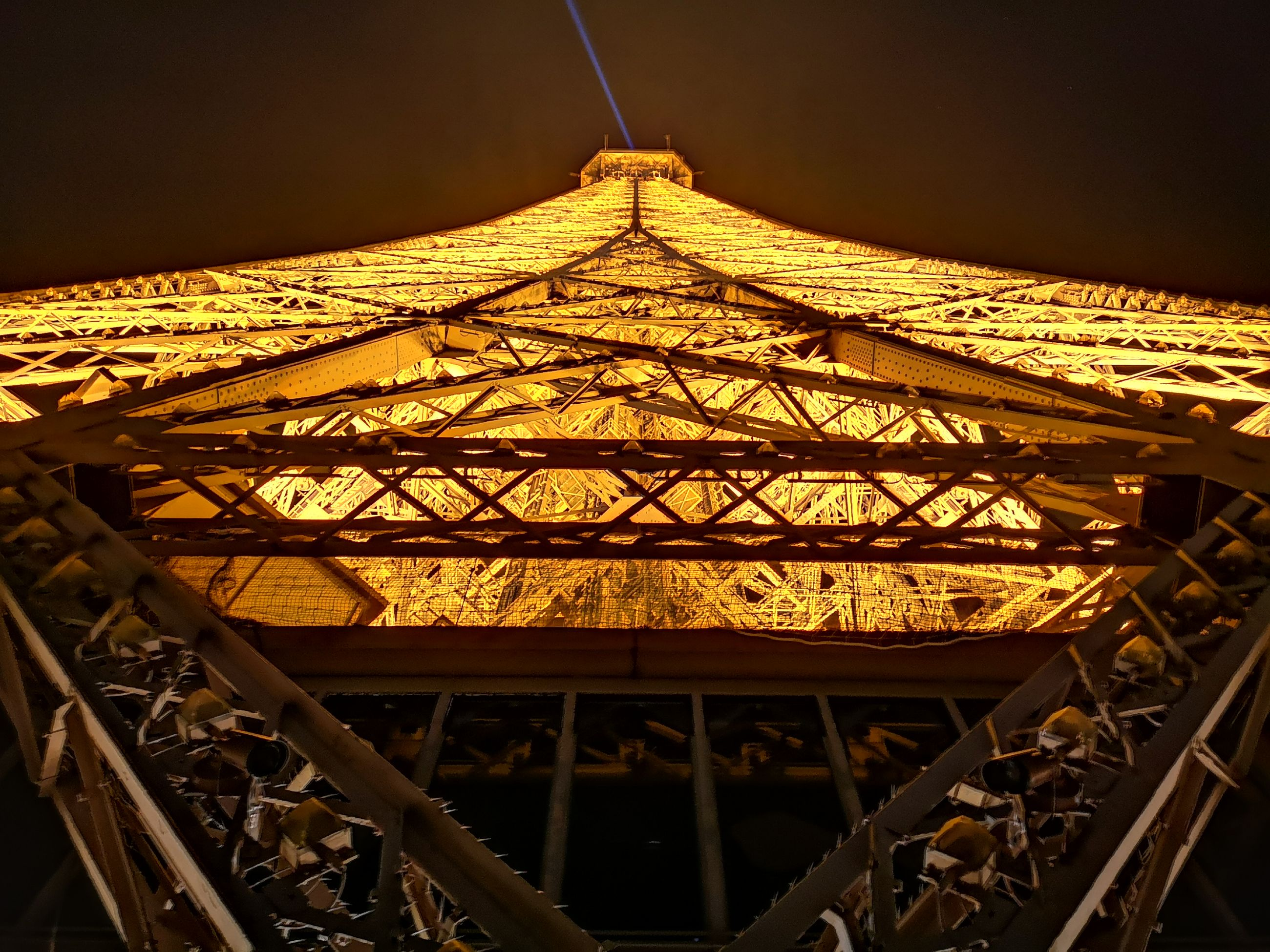 architecture, built structure, illuminated, no people, metal, night, sky, low angle view, building exterior, outdoors, nature, shape, tower, travel destinations, lighting equipment, city, design, building, architectural feature, ceiling
