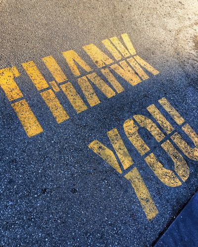High angle view of yellow text on street