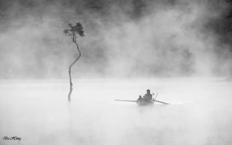 Man rowing boat in river