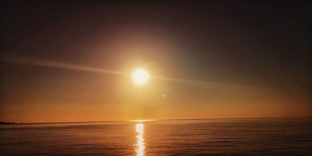 Seascape Sunset_collection EyeEm Nature Lover Sunlight Sunbeam San Teodoro Sardegna Water Sea Sunset Beach Low Tide Sand Sun Horizon Summer Sky Seascape Dramatic Sky Romantic Sky Moody Sky Atmospheric Mood Wave Horizon Over Water