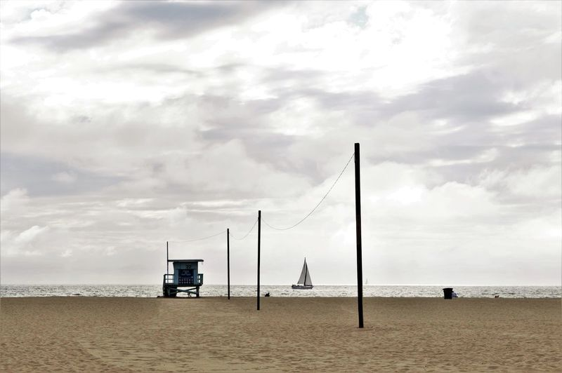 View Of Lifeguard Hut At Beach Against Sky