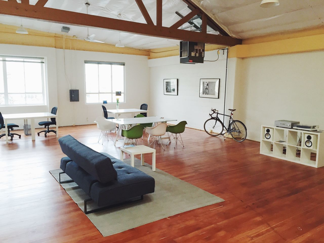 View Of Empty Large Room With Furniture And Bicycle