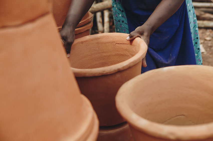 Africa African Brick Business Catching Ceramic Chain Clay Dirt Entrepreneurship Factory Filter Ground Kiln Pots Pottery Social Business Stacked Throwing  Together Warehouse Water Filter Women Working Workshop