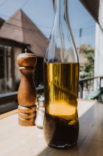 Cooking oil and pepper shaker on a table Thailand Table Drink Food And Drink Focus On Foreground Glass - Material Transparent Still Life Container No People Close-up Freshness Day Glass Food Sunlight Oil Cooking Cooking Oil Pepper Shaker Pepper