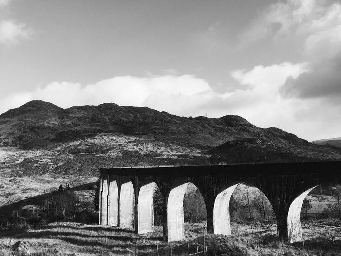 Arched bridge against sky