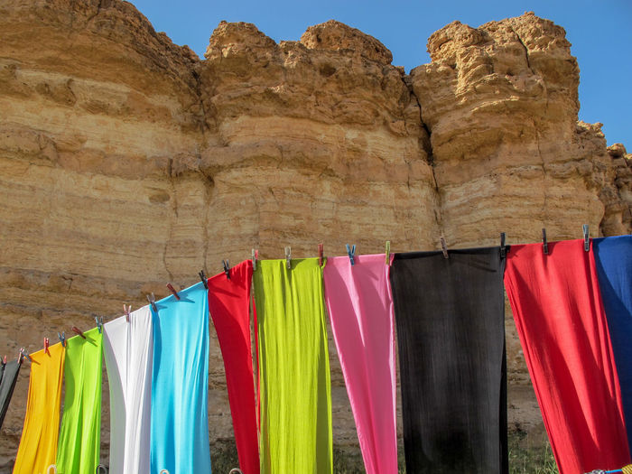 Tunisia travel holidays colorful Hanging No People Multi Colored Textile Day Side By Side Clothing Low Angle View Nature Drying Rock Formation Sunlight Laundry Clothesline Choice Built Structure Rock Architecture Outdoors Variation Colorful