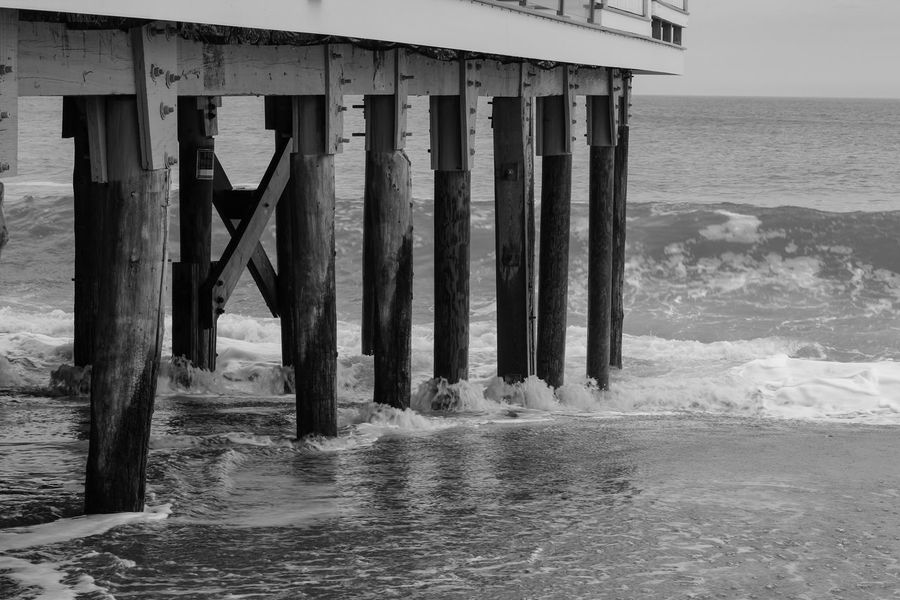 """""""Tide"""" Photographed by AJTinker AjTinkerPhotography Sea Water Horizon Over Water Beach Pier Architecture Built Structure Underneath Nature Outdoors Day Waterfront Scenics No People Architectural Column Wave Beauty In Nature Black & White Black And White EyeEm Best Shots Tranquil Scene EyeEmSelect Blackandwhite Photography Perspectives On Nature Perspectives On Nature Black And White Friday"""