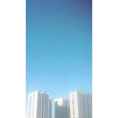 Outdoors Copy Space Blue Building Exterior Clear Sky Architecture Built Structure City No People Low Angle View Skyscraper Day Cityscape Sky Building Story Office Block