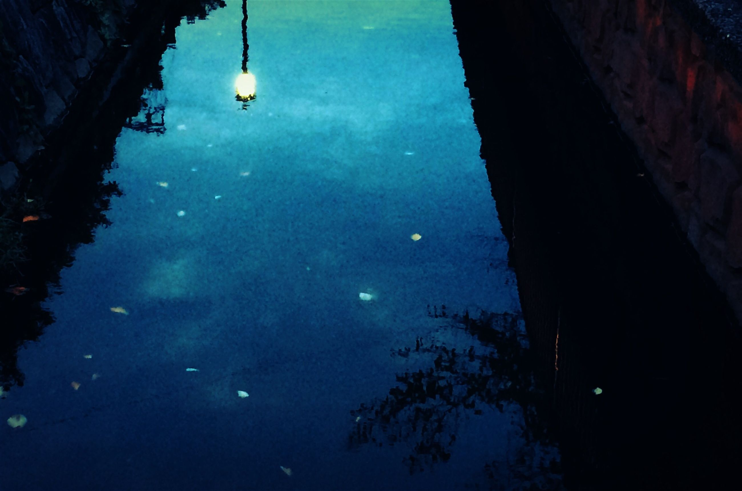 water, reflection, night, sky, built structure, building exterior, illuminated, standing water, architecture, waterfront, tranquility, nature, blue, no people, moon, dusk, low angle view, outdoors, puddle, lighting equipment