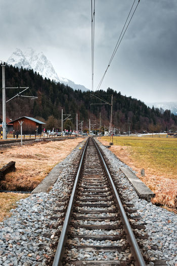 Train tracks in the alps Rail Transportation Railroad Track Track Direction The Way Forward Tree Nature Outdoors Connection Train Railroad Station Platform Railroad Leading Leading Lines Way Path Contrast Bavaria Bayern Alpen Alps Bahnhof Cottage Germany It's About The Journey